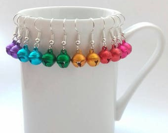 Bright bell earrings. Tiny bells. Rainbow colours. Red. Gold. Green. Blue. Purple. Christmas baubles. Shiny. Jingle. Jangle. Quirky. Festive