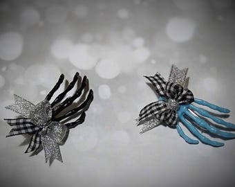 Plastic skeleton hand hair accessories, with small bows.