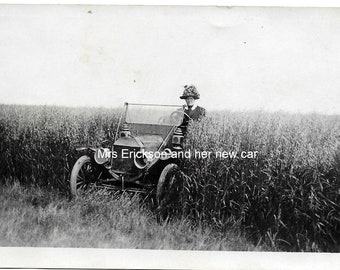 RPPC Real Photo postcard, lady driving her new car. Mrs Erickson got lost :) C1912