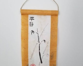 Tranquility in Japanese calligraphy on a small wall scroll with minimalist bamboo art