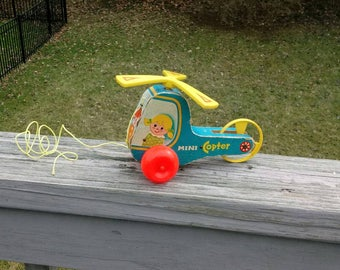 Vintage Fisher Price mini copter pull toy