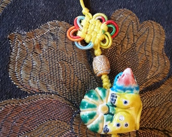 Chinese Charm tassel, chicken?