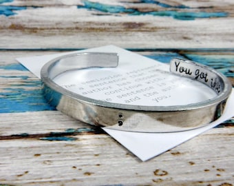 Semi colon hand stamped cuff, my story continues. A unique and thoughtful keepsake