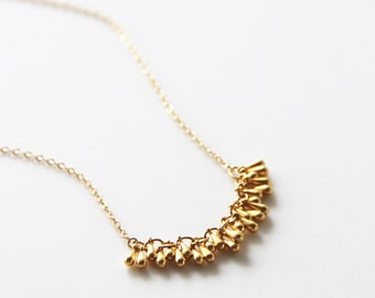 """Delicate & Stunning Tiny Gold Raindrop Necklace. Lenght 14"""" with a link to 16"""""""