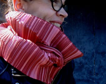 Promo Studio space. Scarf/cowl coral pleated fabric. origami effect. Collar quilted blanket and Popper