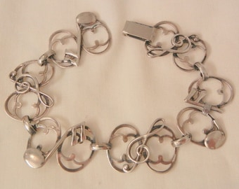 Vintage Sterling G clef sixteen note music link Bracelet