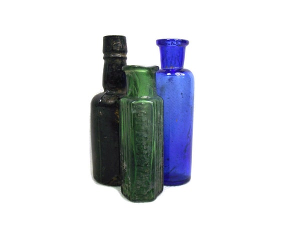 Set of Small English Antique Glass Bottles