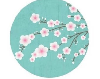 20mm, pink cherry blossoms, green background of water