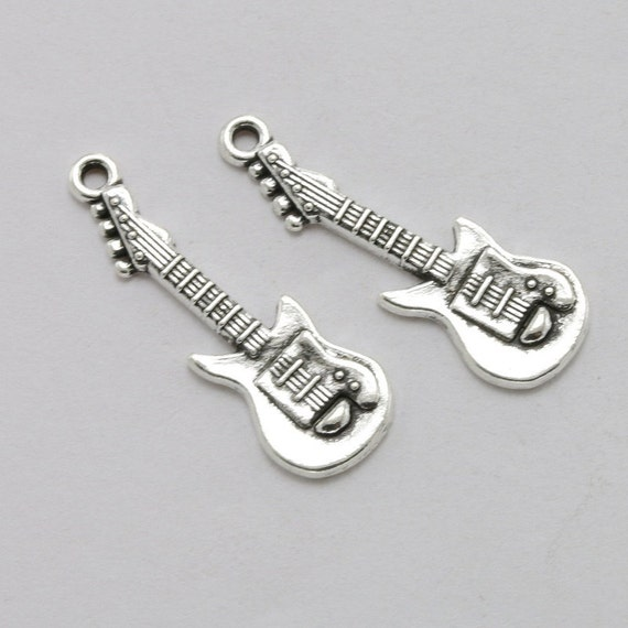 8 guitar pendants large charms very nice quality silver tone music 8 guitar pendants large charms very nice quality silver tone music band rock guitars charm pendant craft jewelry suplies 30x10 mm from charmingmaggie on aloadofball Choice Image