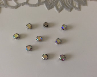 Set of 200 rhinestones set in crital has 3 4 mm tooth