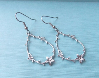 Delicate Floral Earrings, Teardrop Tree Branch w Flowers Pendant Earrings, oval loop branches w flower pattern, silvertone hanging hoop twig