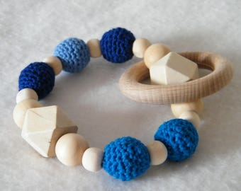 Raw wood and blue teething rattle