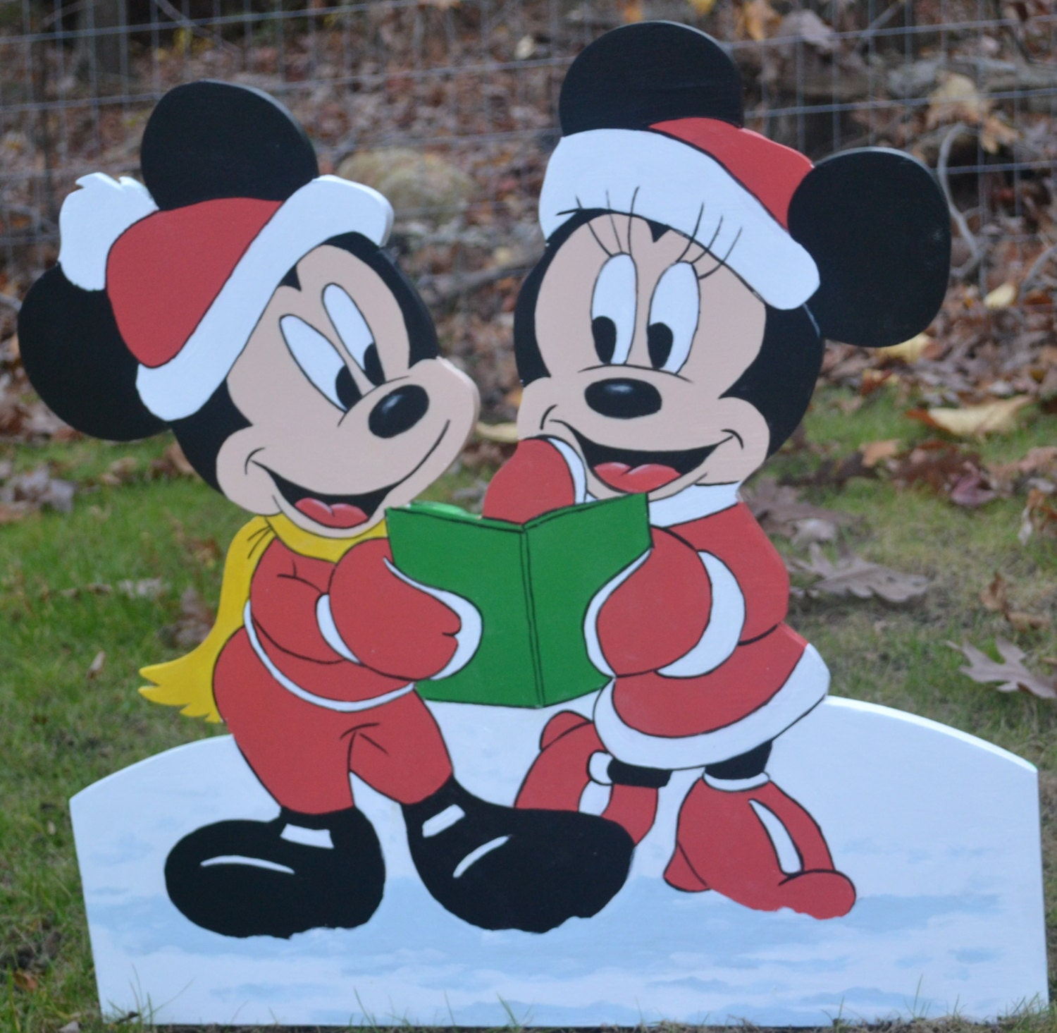 Mickey Mouse and Minnie Mouse singing Christmas Carols lawn