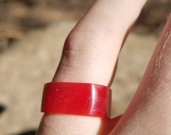 Unique Square ring made out of a bright red shiny resin