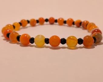 Faceted Dyed Orange Agate Stretch Bracelet with Black Acrylic Beads