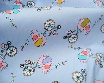 C135 - 1 meter Cotton Fabric - Cartoon - elephant and Bicycle on light blue (145cm width)