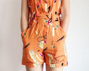 Vintage 80s romper playsuit / orange graffiti cotton sunsuit / jumper tank top shorts suit / deadstock novelty jumpsuit / size S small
