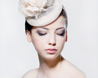 Ivory sinamay headpiece with silk roses, veiling and sinamay curls perfect for a wedding/ the Melbourne Cup.
