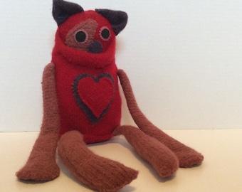 Handmade repurposed sweater monster. Stuffed monster.