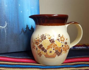 Fruit and flowers pitcher