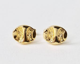 Vintage gold plated oval abstract 1970's cufflinks. Oval swirl pattern gold plated cufflinks. Pressed pattern effect. 70's oval cufflinks.