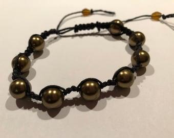 Fine black hemp Shambhala-style bracelet with olive-bronze metallic beads