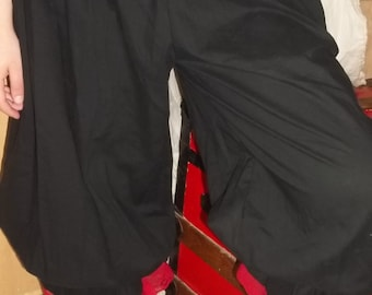 Plus black cotton pantaloons with red lace trim
