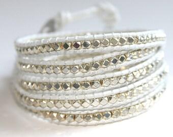 Silver bead wrap bracelet on white leather