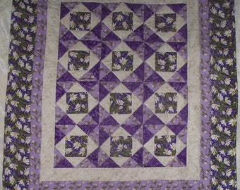 Handmade quilt in 100% cotton 42.5 inches by 51 inches.