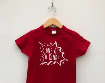 Light Your Spark Red Children's T-shirt with 'One of a Kind' design in white