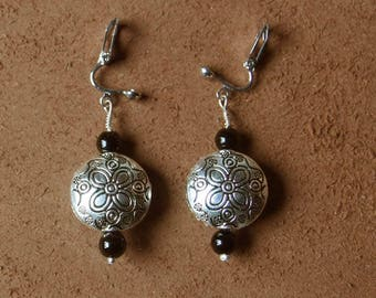 """Earrings from the collection """"Distant Asia"""" reason these lands mineral treasures."""