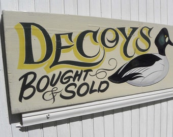 Handmade and hand lettered Decoy Sign. Hand painted Art. Decoy on ivory background with Bought & Sold and pinstriping in black. Great gift