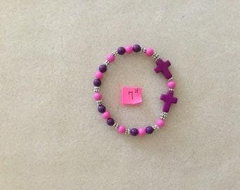 "7"" Purple Crosses Stretch Cord Bracelet."