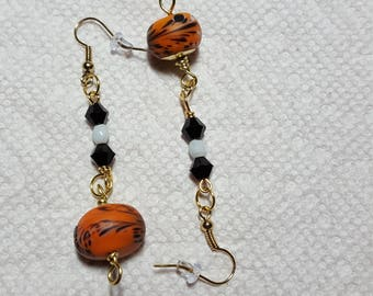 Orange Dangle Earrings with Goldtone Accents.