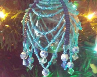Shades of blue hand  beaded Christmas ball ornament cover.