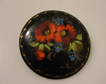 "Lacquer tole pin painted red & blue flowers black background signed oval brooch 2"" diameter"