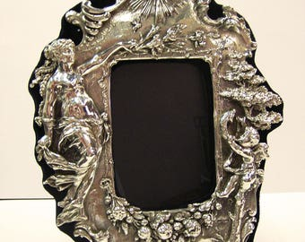 Sterling silver  picture frame.  Figural. Handcrafted.