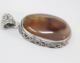 Gorgeous one-of-a-kind natural stone pendant necklace in Bali design silver frame