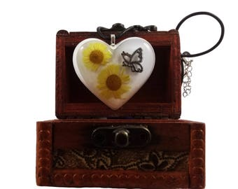 Buy Necklace cast resin pendant with 2 marigold flowers handmade