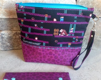 Donkey Kong inspired project zipper pouch with flat bottom and knitting needle cozy