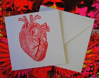 Linocut. Postcard printed by hand with an anatomical heart.