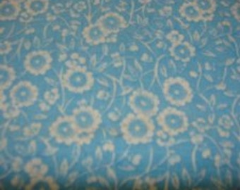 White Flowers on soft Blue Cotton Fabric