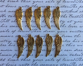 Ten pewter wing pendents-small gold tone wing charms