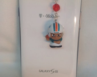 Miami Dolphins football cellphone charm iPhone charm, iPad charm, dust plug charm, headphone jack charm, galaxy cellphone and note charm.
