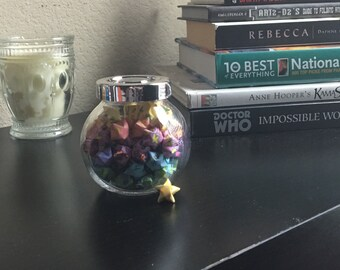 Small glass jar (sealed) with origami stars