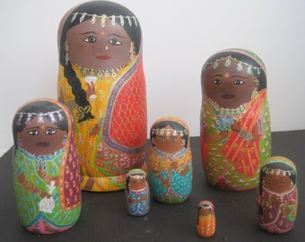 set of 8 nesting dolls wooden lime; painted acrylic