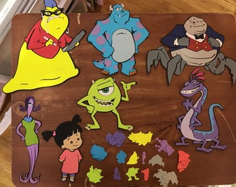 Set of 7 Monsters Character die cuts with 100 pieces of Table Confetti including..Mike, Boo, Sulley, Randall, Waternoos, Roz and Celia