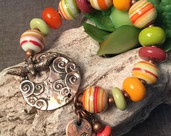 MANGO SUNSET, artisan lampwork and copper bracelet