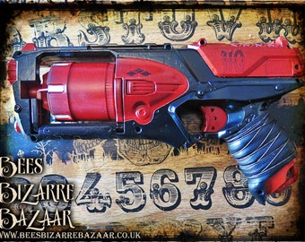 ... this used to be a Triple Barrel Nerf Gun, but that was before  Nerfenstein worked through it to give it the distinctive Steampunk look and  gauges, ...