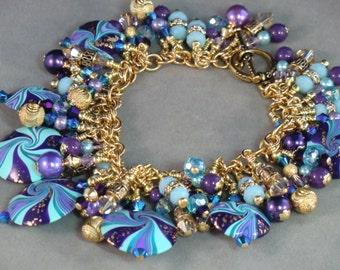 SALE! Cha cha charm bracelet in purple, mint, aqua and 24k gold swarovski crystal polymer clay swirl beaded dangle bracelet pale blue purple